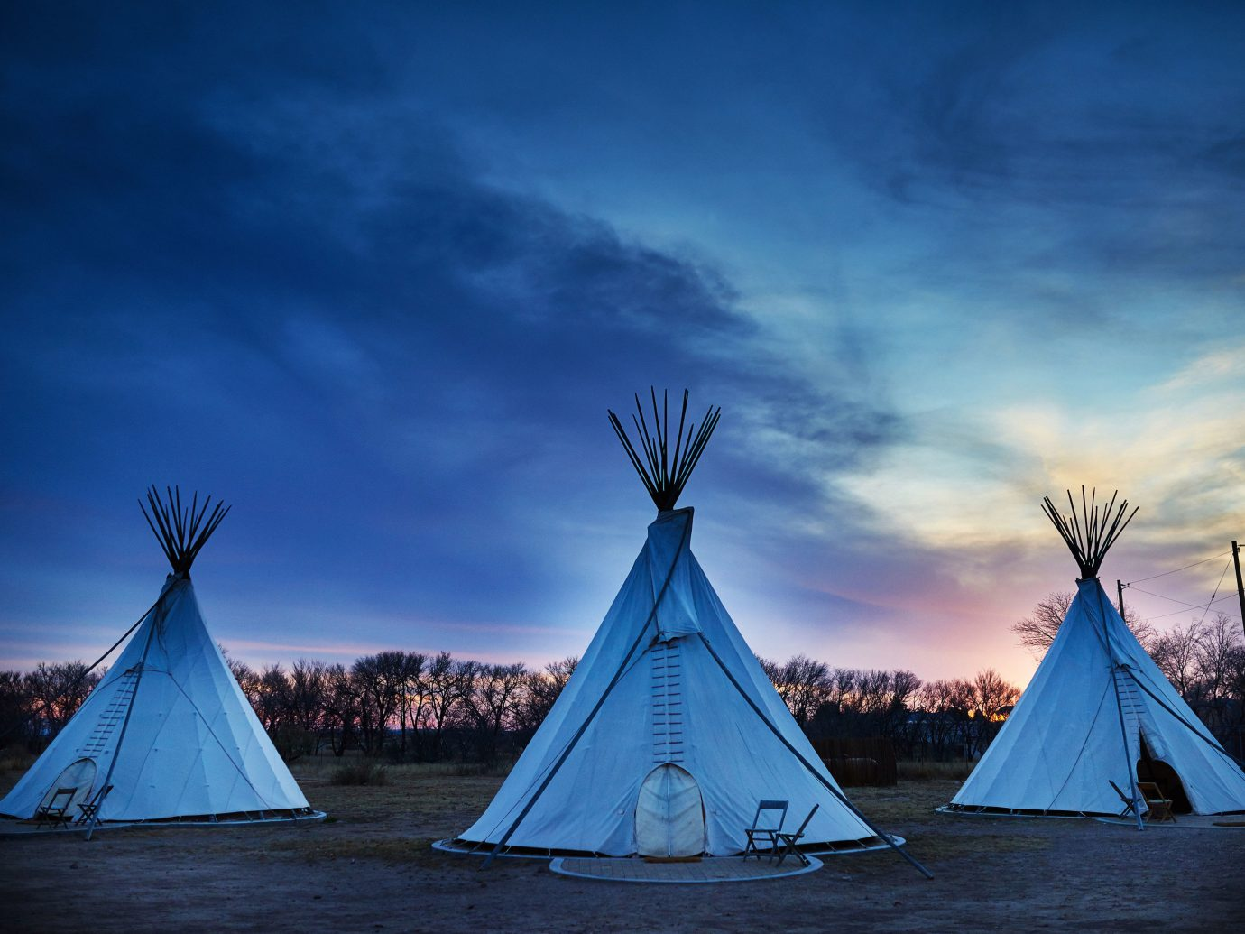 Glamping Luxury Travel Outdoors + Adventure tepee sky outdoor water building blue cloud light Sea night horizon evening Winter morning dusk sunlight Ocean reflection ice lit Sunset several