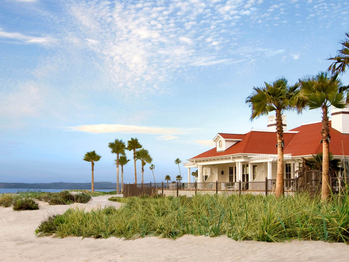 Beach Exterior Grounds Hotels Ocean Waterfront outdoor sky grass house body of water shore vacation Sea caribbean Coast Resort arecales landscape bay estate tropics sign