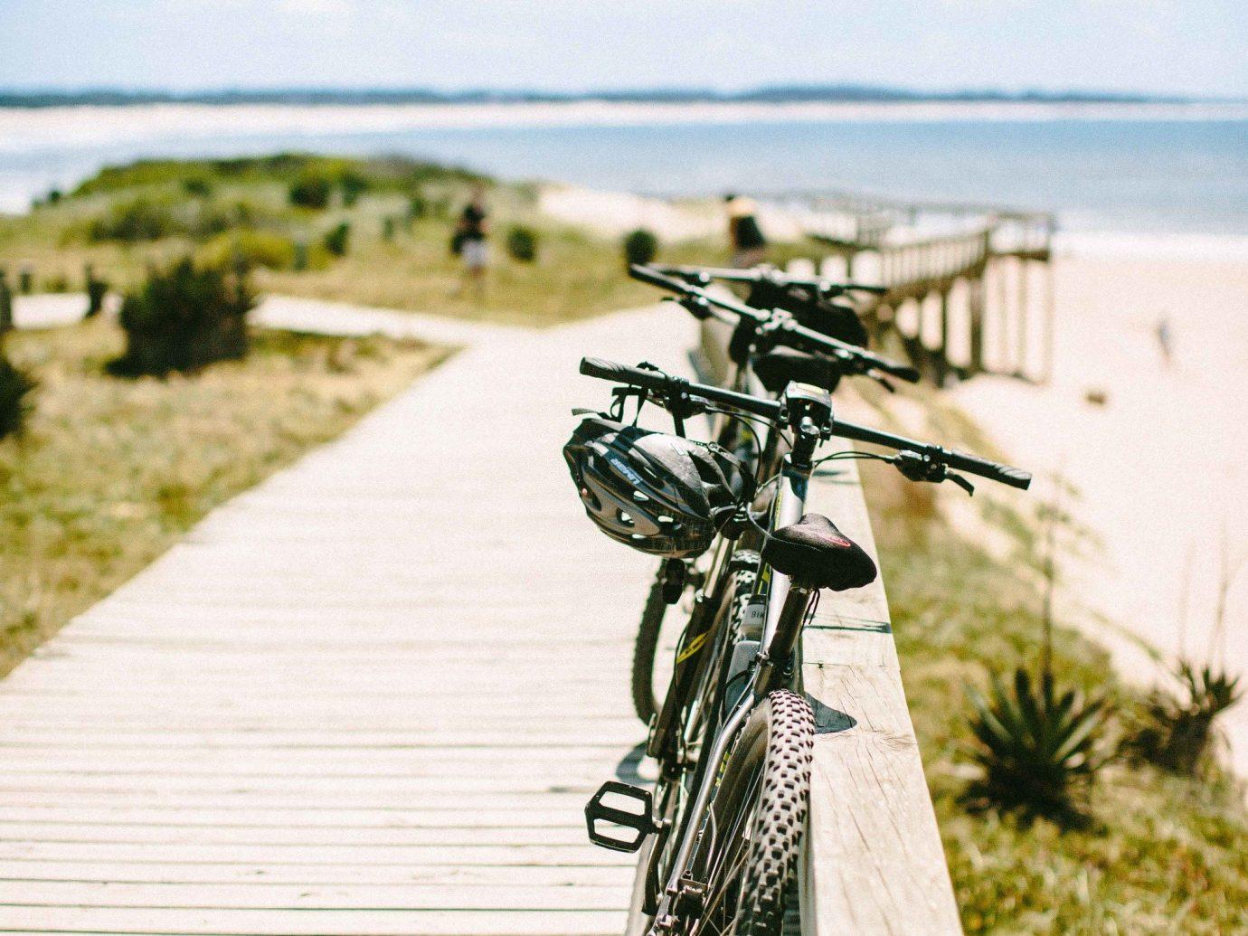 Beach Romantic Getaways south america Trip Ideas Uruguay road bicycle bicycle sky tree path grass Sea vacation boardwalk plant cycling hybrid bicycle cloud recreation