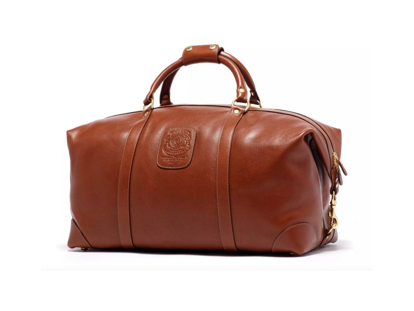 Packing Tips Style + Design Travel Shop accessory case bag leather brown suitcase luggage handbag indoor fashion accessory piece product caramel color shoulder bag suit peach hand luggage strap product design brand baggage tan colored