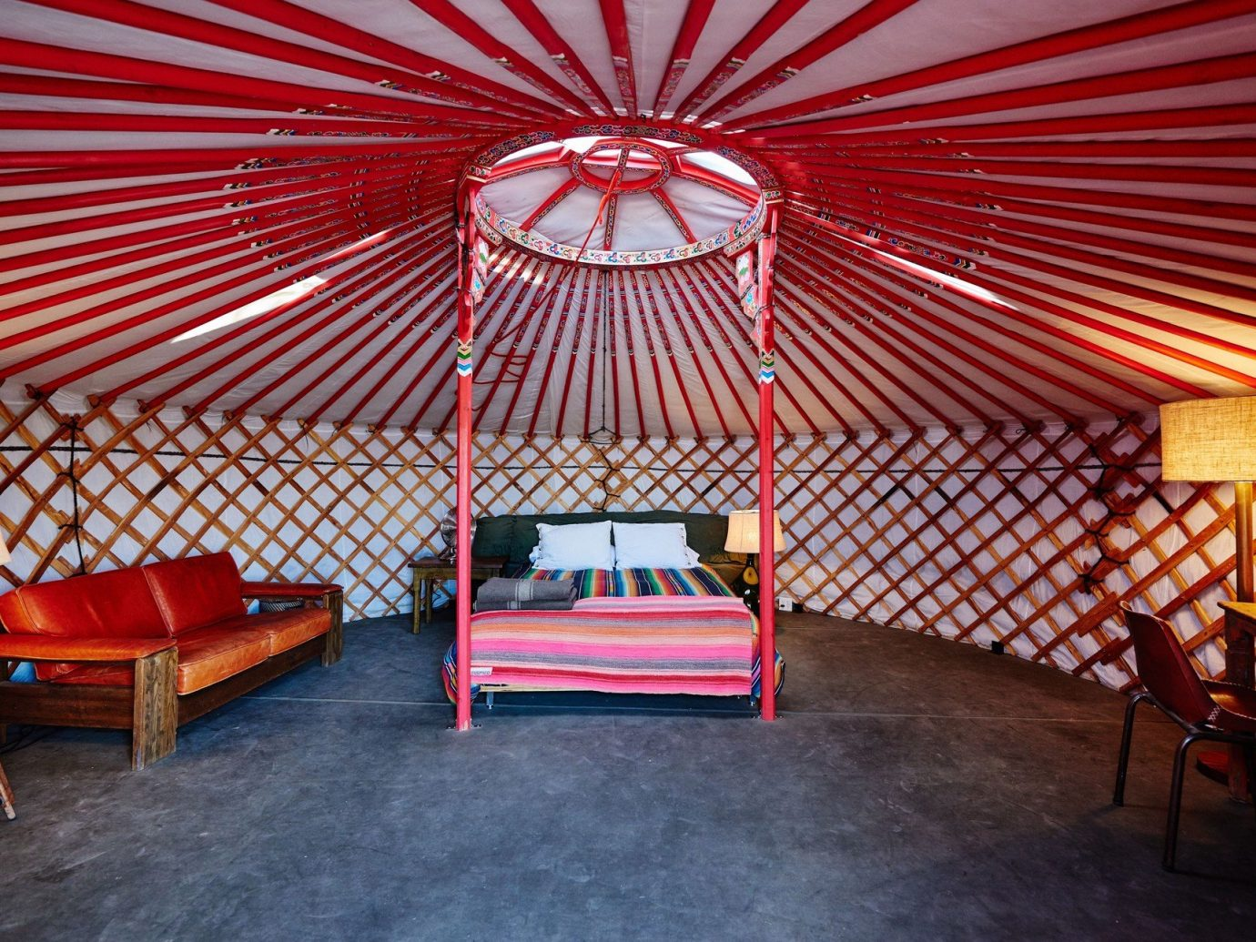 artistic artsy bed Bedroom Glamping Hip interior isolation living area living room Outdoors + Adventure quirky remote tent tents trendy Weekend Getaways floor chair indoor room red umbrella stage accessory interior design area furniture