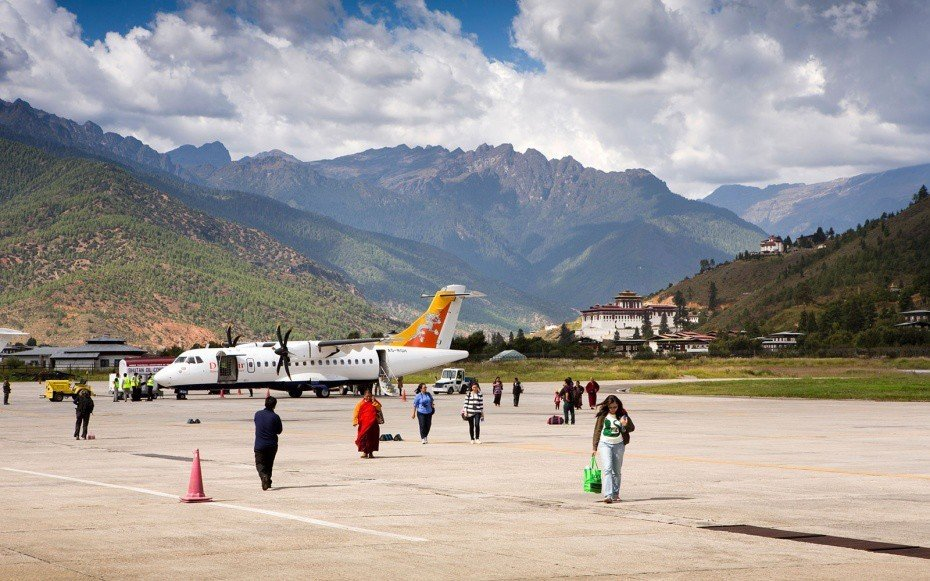 Offbeat mountain sky outdoor ground Nature people atmosphere of earth mountain range vehicle aircraft group airplane flight aviation shore highland
