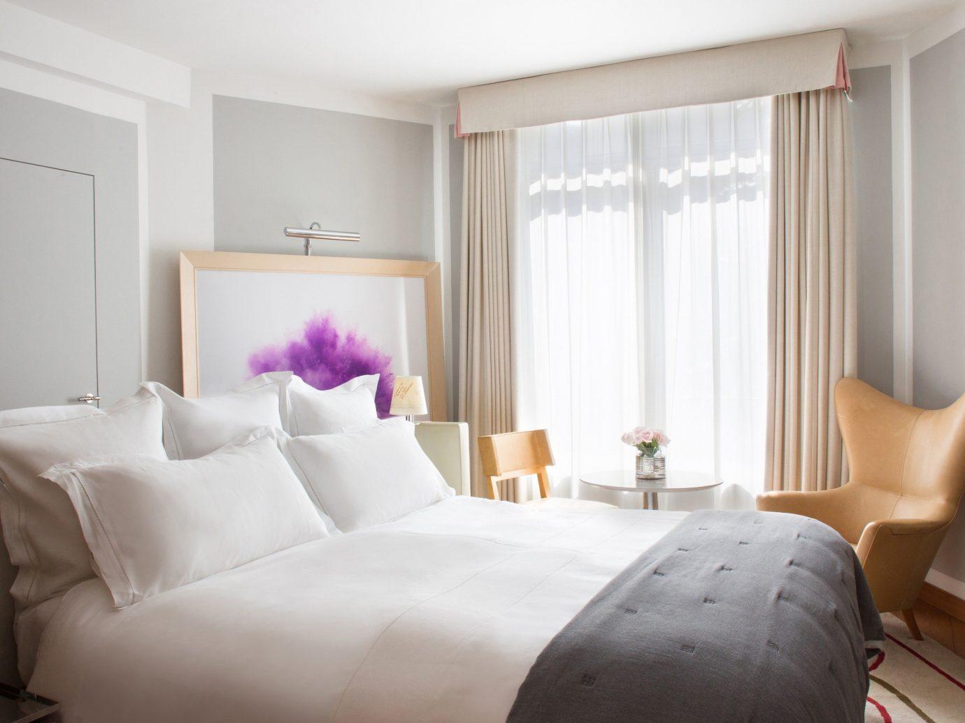 Hotels indoor wall bed room Bedroom property window ceiling Suite interior design home living room hotel cottage real estate estate apartment bed sheet furniture