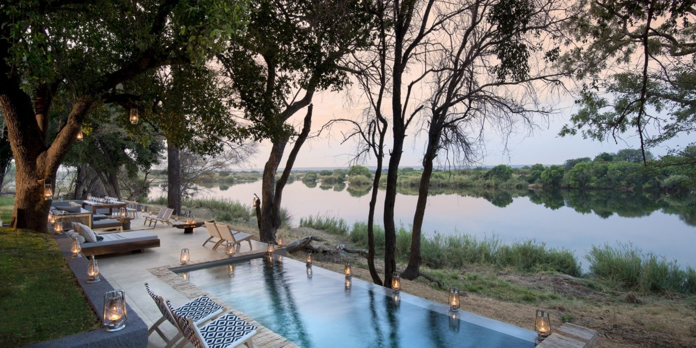 Hotels Luxury Travel Trip Ideas tree outdoor water grass River Lake property swimming pool estate backyard waterway overlooking surrounded