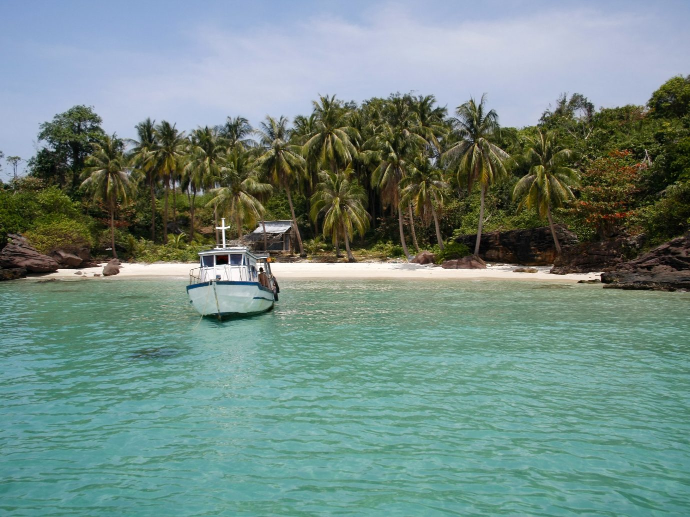 Romantic Getaways outdoor tree water sky waterway body of water coastal and oceanic landforms Sea tropics Lagoon Resort arecales bay caribbean Island Coast Boat palm tree shore Ocean inlet tourism leisure vacation plant community plant cove Beach cay landscape Jungle surrounded day several