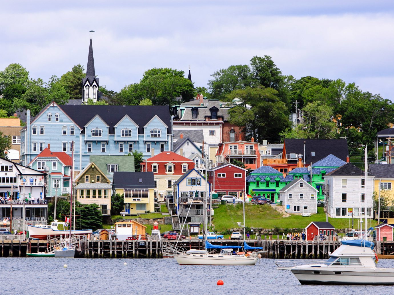 Trip Ideas outdoor Boat water Town geographical feature scene neighbourhood residential area human settlement River vacation cityscape waterway vehicle Harbor Coast Village docked several