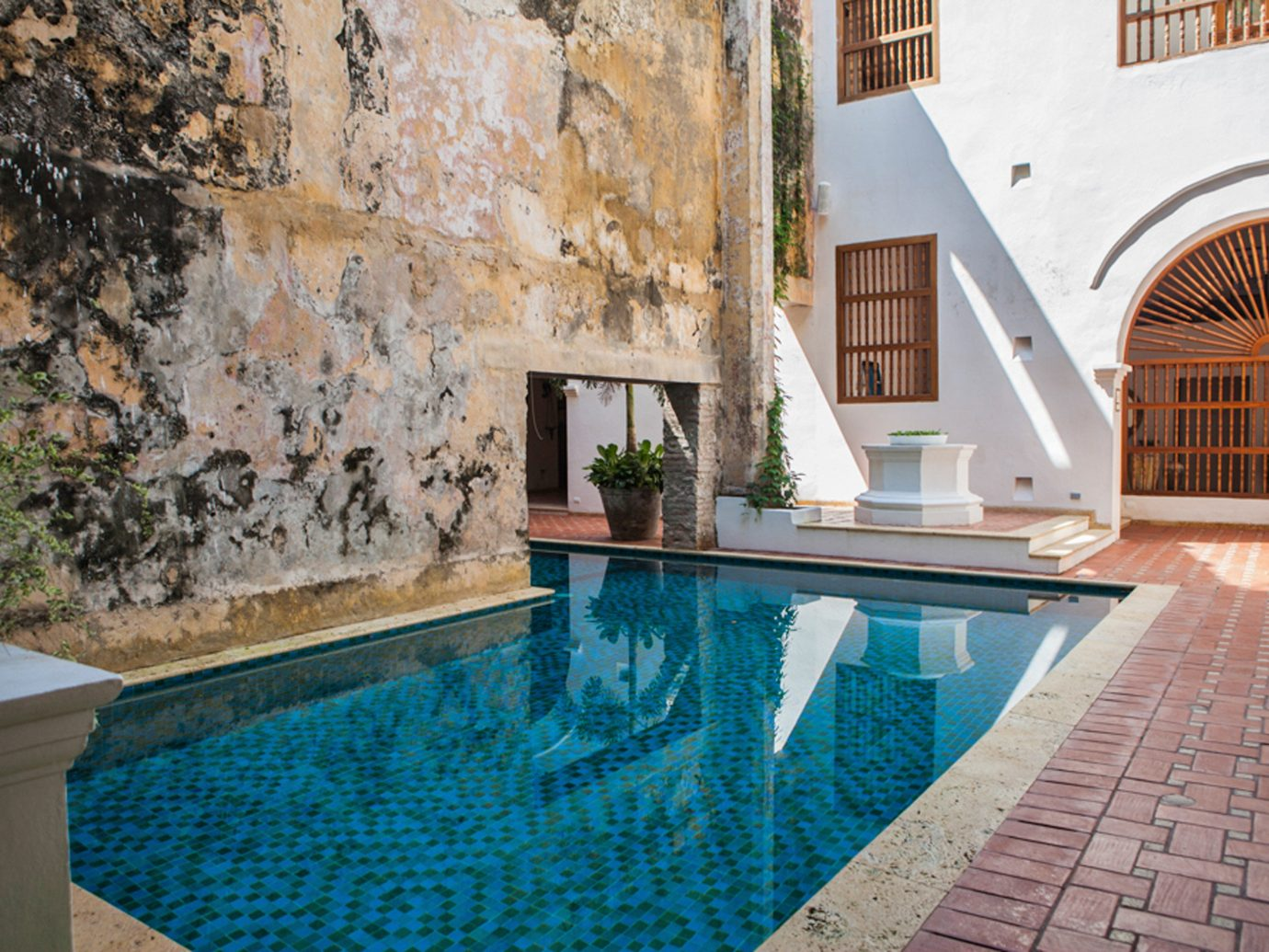 Design Hotels Luxury Play Pool Resort Romance Solo Travel Trip Ideas building swimming pool property estate brick stone backyard Villa Courtyard floor home cottage mansion real estate