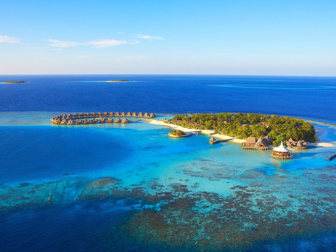 Hotels Trip Ideas water sky Ocean reef blue Nature outdoor geographical feature landform Sea Boat archipelago horizon Coast islet Beach caribbean shore vacation bay Lagoon Island cape cove clear Resort atoll swimming distance