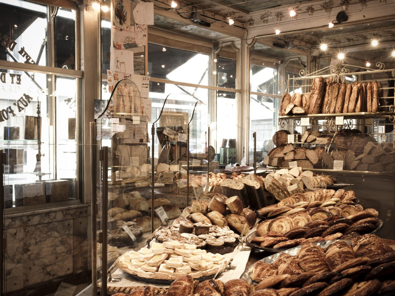 Food + Drink France Paris indoor pastry bakery building case wood food market stall store Shop baked sale several