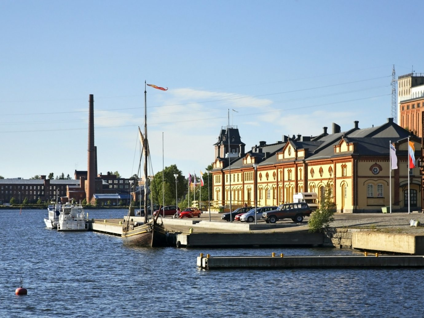 Finland Trip Ideas sky water outdoor waterway body of water Boat Harbor water transportation Town Canal channel vehicle River City boating watercraft marina tree port ship house day