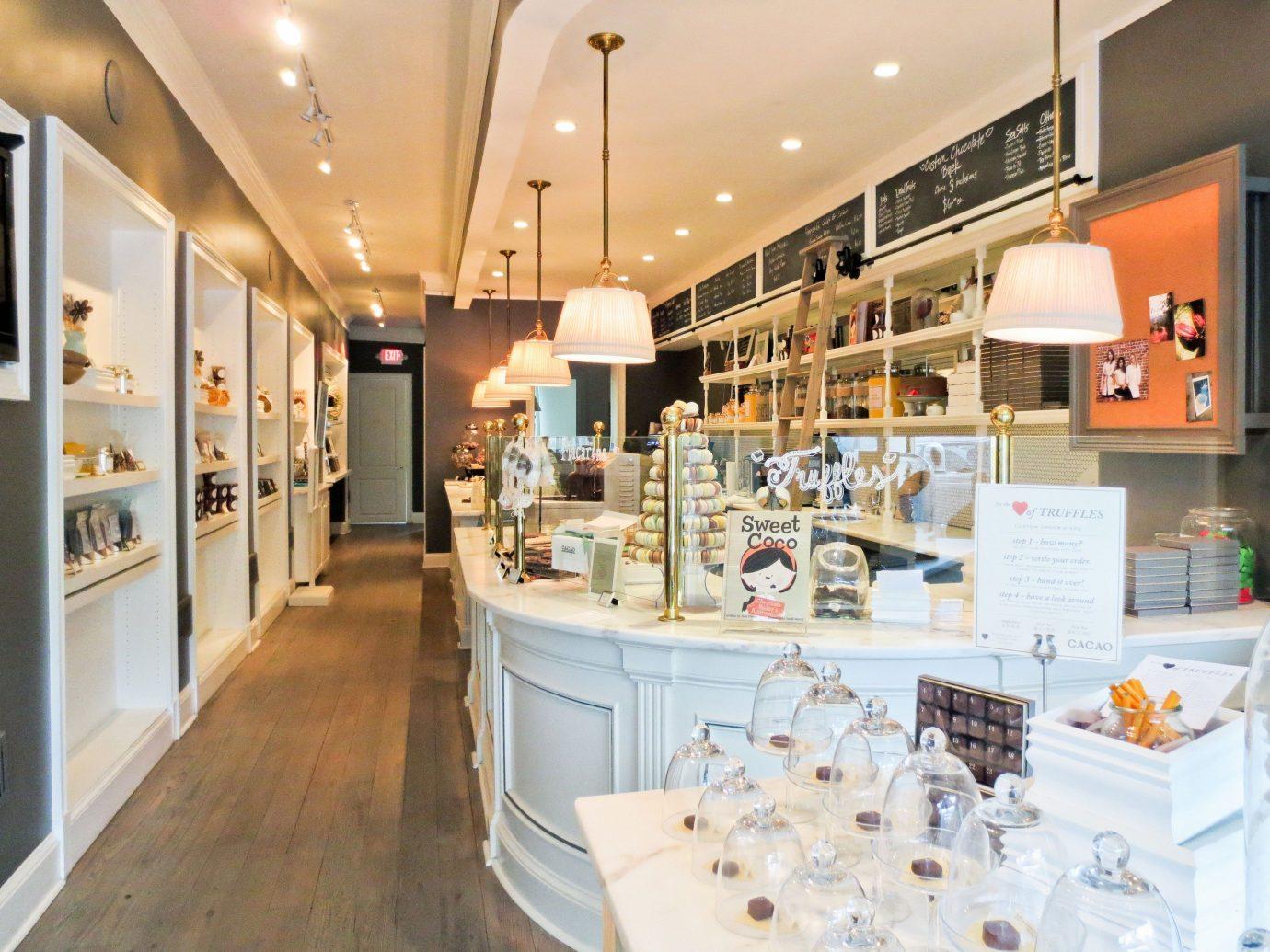 Food + Drink indoor floor retail room Boutique interior design bakery Design shoe store counter