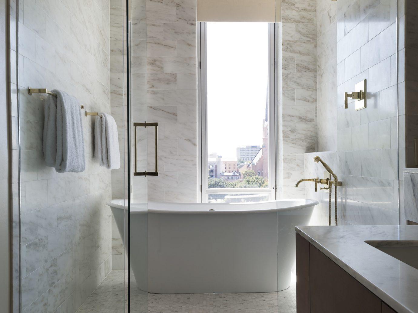 Hotels indoor bathroom room property window floor plumbing fixture interior design bathtub flooring tile Design sink apartment