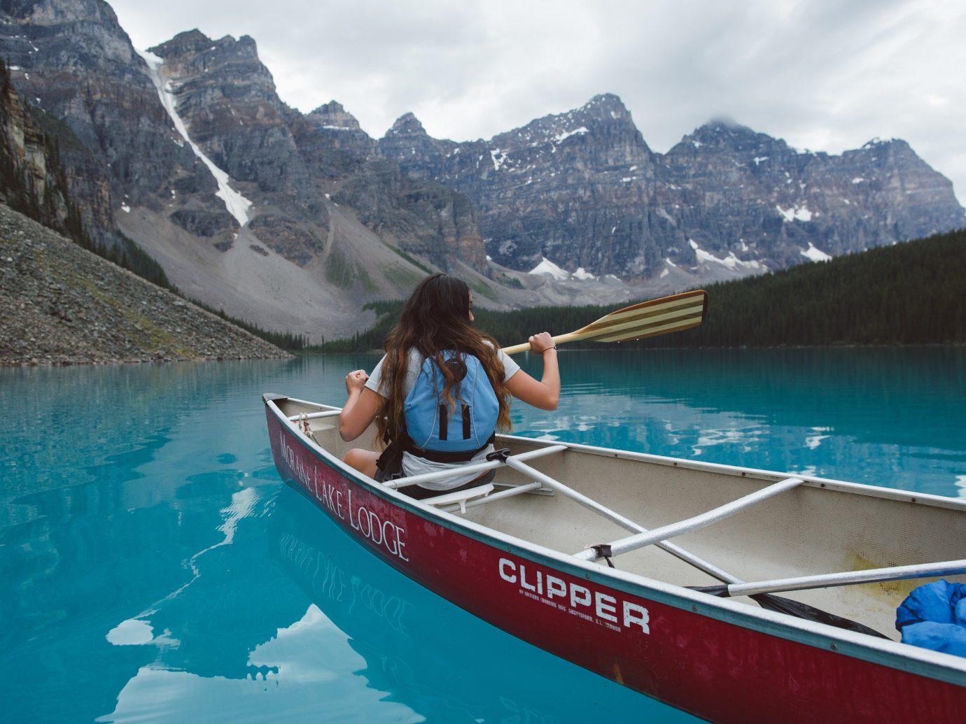 Mountains + Skiing National Parks Outdoors + Adventure Trip Ideas Weekend Getaways mountain water Boat sky outdoor boating vehicle watercraft rowing canoe vacation Sea watercraft sea kayak Lake bay canoeing paddle