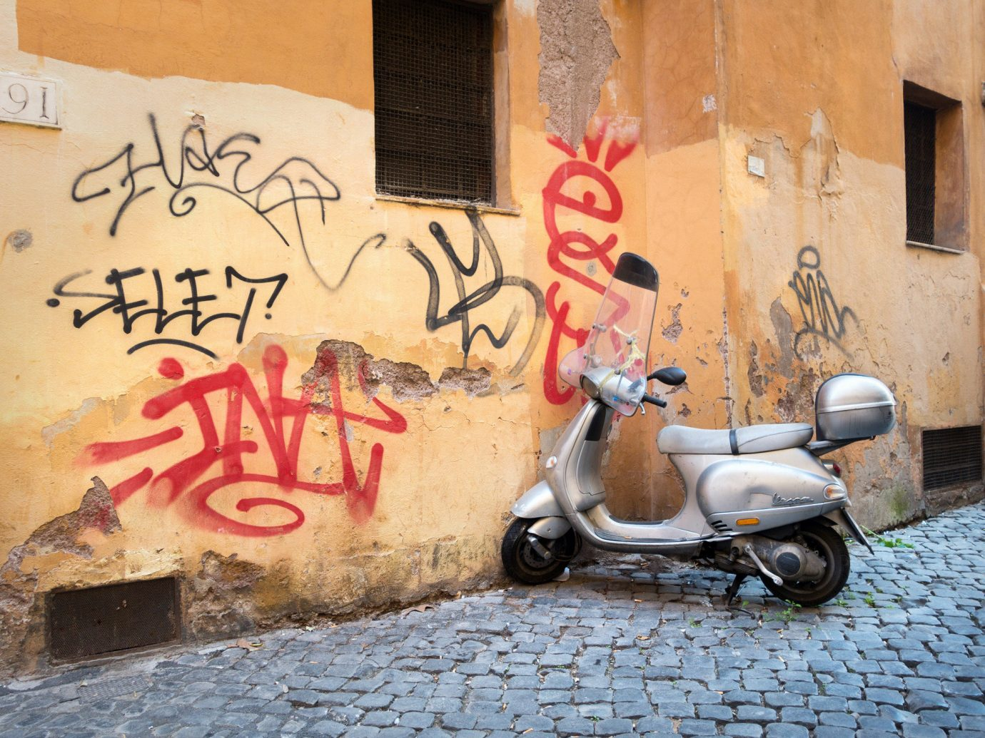 Travel Tips building outdoor graffiti art wall street art parked abstract street vehicle mural road painted scooter