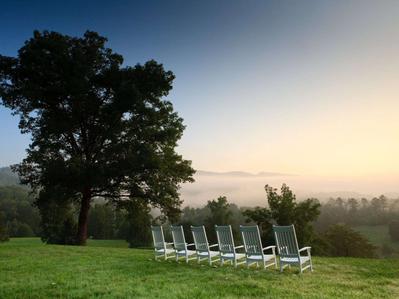 Hotels outdoor sky tree grass Nature field atmospheric phenomenon pasture ecosystem chair meadow morning seat woody plant rural area hill landscape sunlight flower lush