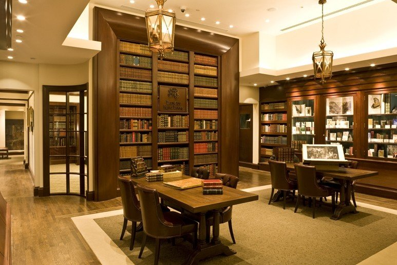 ambient lighting antiques books calm cozy desk Food + Drink Historic interior library Rustic vintage floor indoor table room Living building ceiling retail interior design Design bookselling furniture dining room