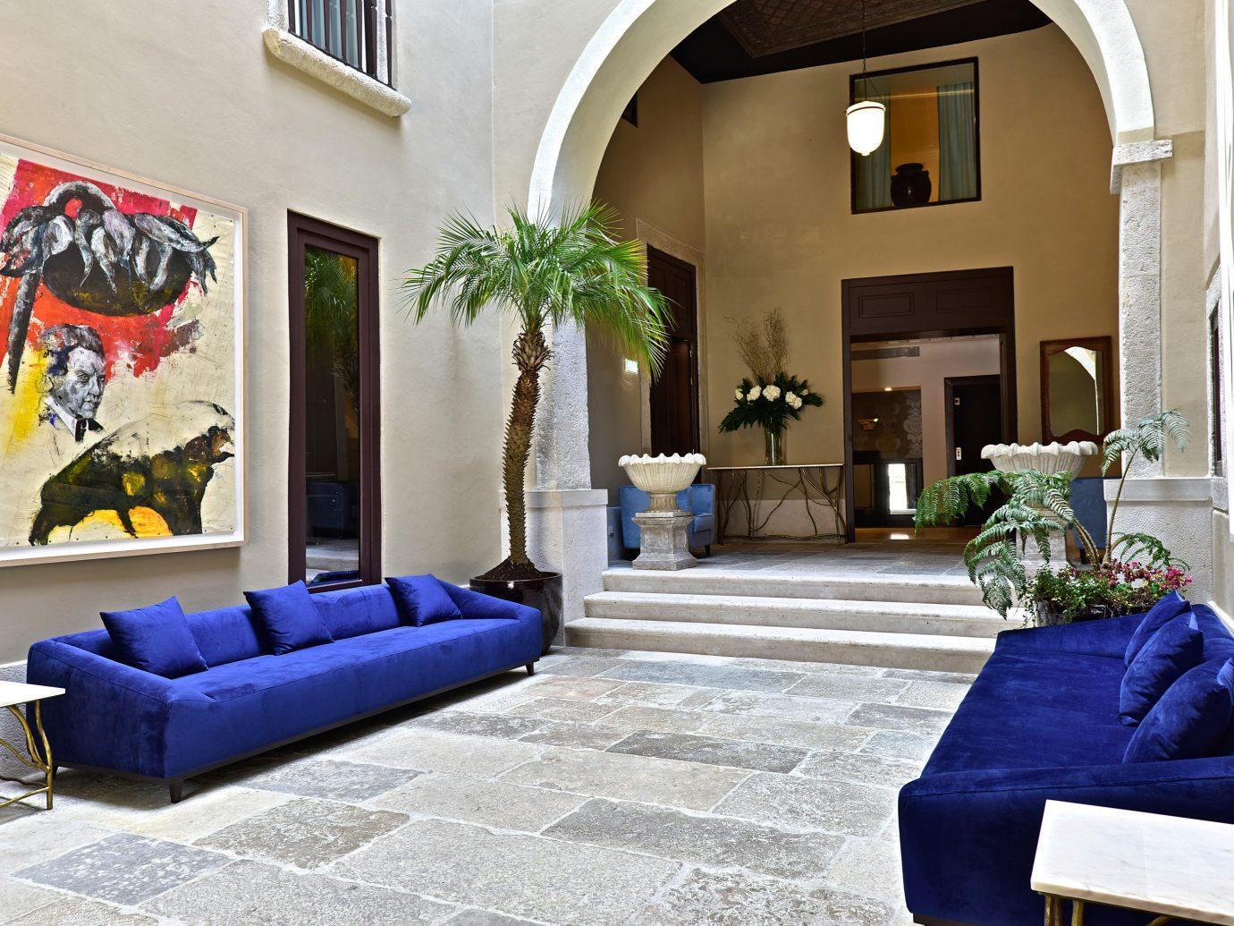 Hotels room property living room indoor Living estate home house interior design mansion Villa real estate cottage Design porch blue furniture decorated stone