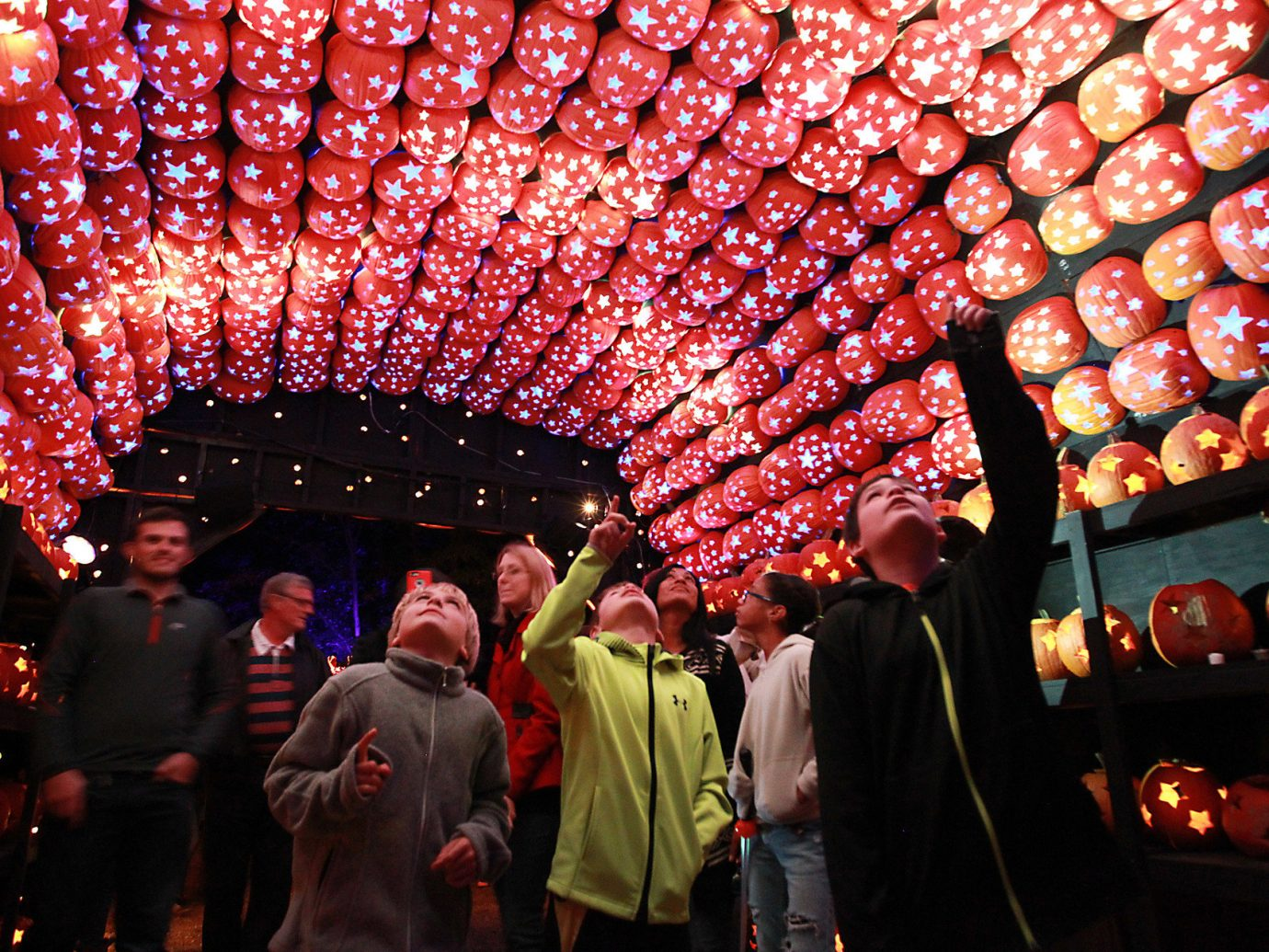 activities art Arts + Culture festive halloween lights night people pumpkins Trip Ideas person color crowd red stage nightclub chinese new year festival