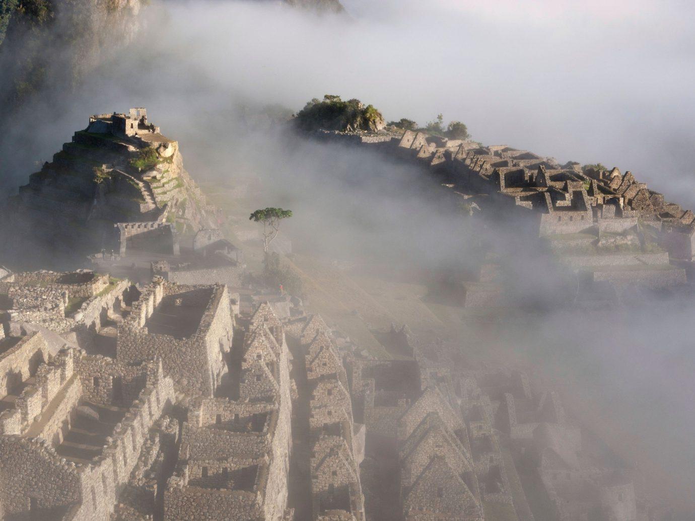 Trip Ideas outdoor smoke atmospheric phenomenon geological phenomenon military vehicle atmosphere of earth steam vehicle aerial photography mountain screenshot terrain spring stack
