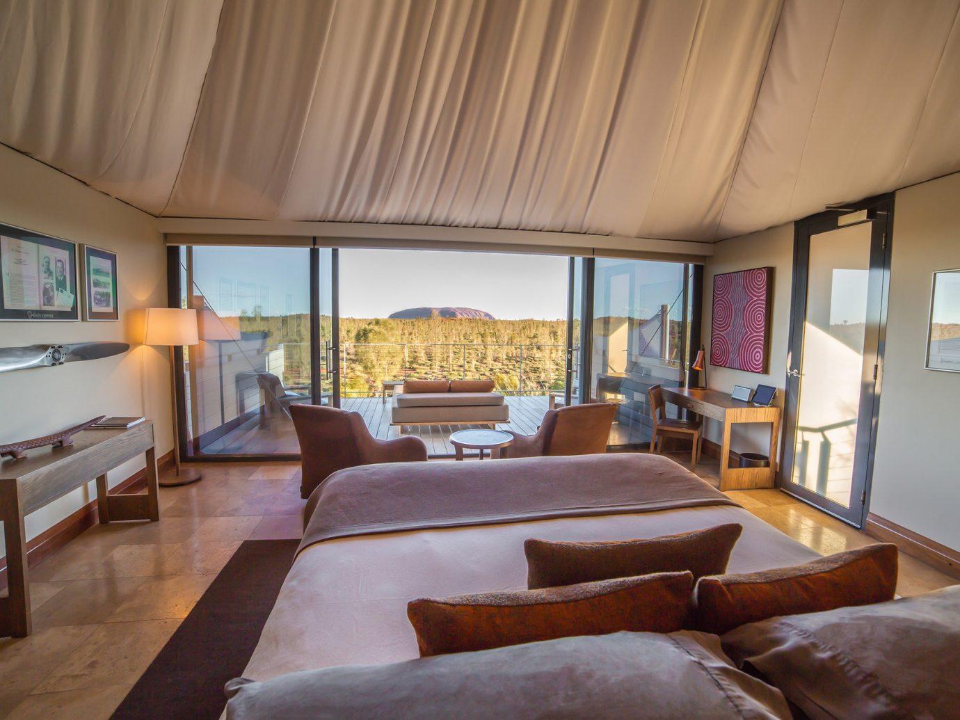 Hotels indoor room floor sofa Living property ceiling estate real estate vehicle home Resort interior design living room cottage Suite Villa apartment furniture