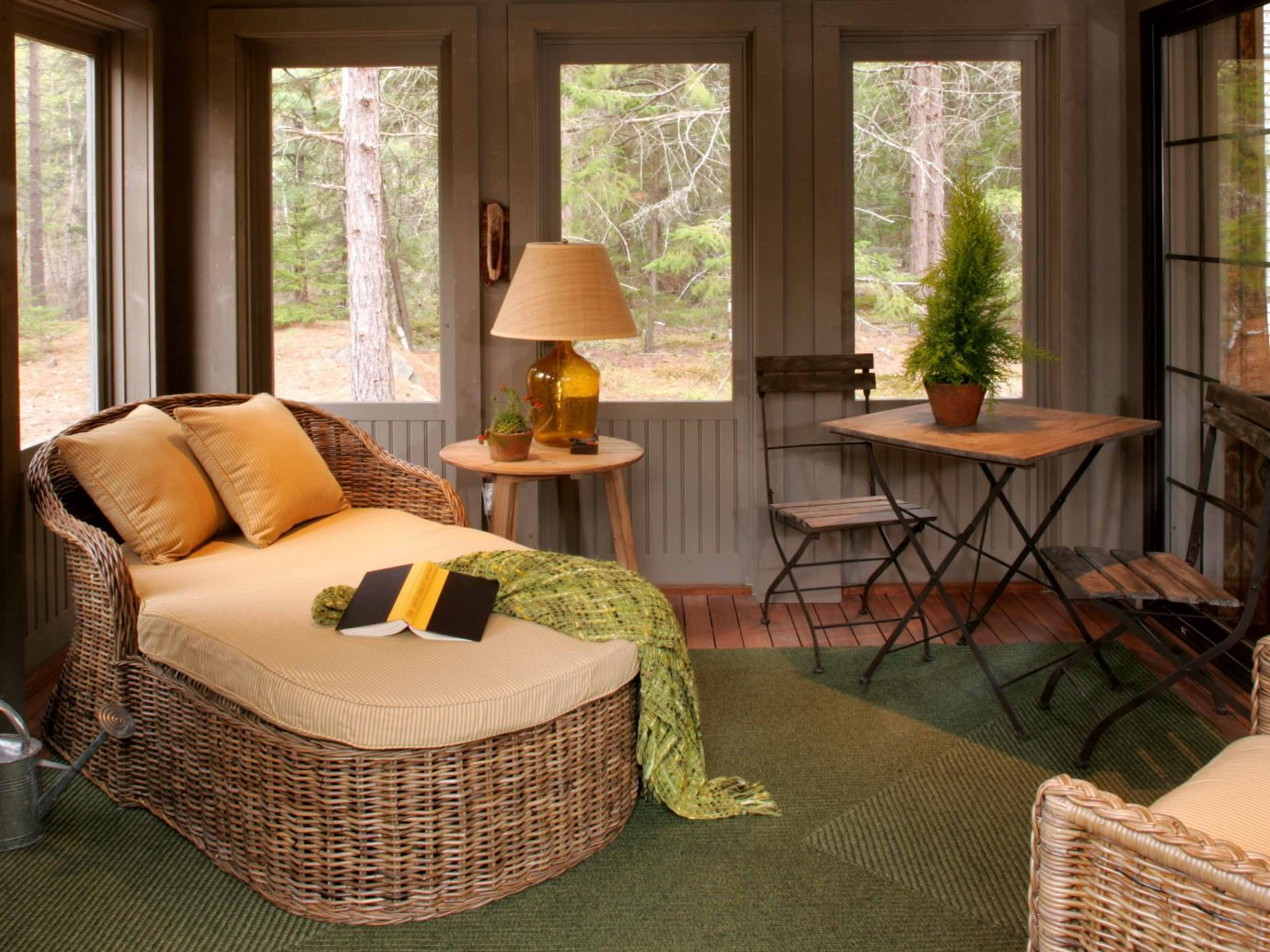 Romance Trip Ideas Weekend Getaways indoor window room Living sofa floor living room interior design furniture home green real estate chair estate porch outdoor structure wicker Suite table area decorated
