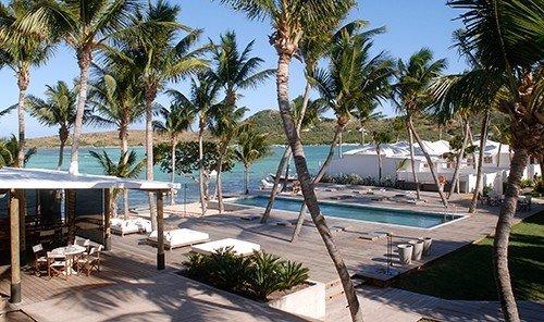Budget tree outdoor palm sky umbrella property Resort Pool caribbean plant vacation Villa estate real estate swimming pool marina condominium lined area shore furniture sandy shade several