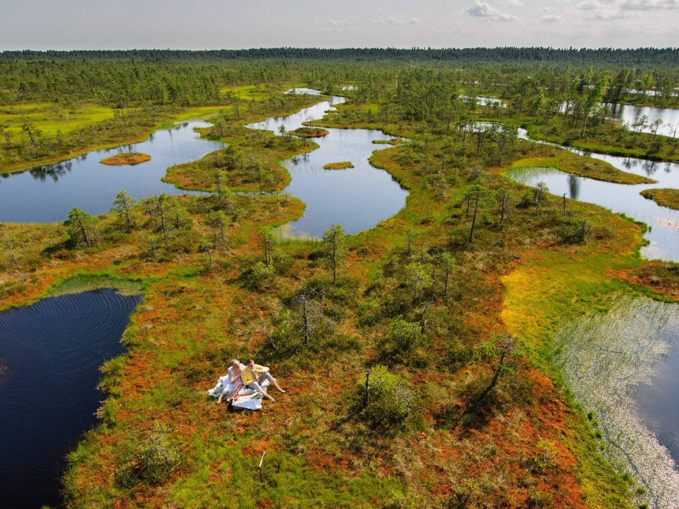 Offbeat grass water outdoor sky River habitat aerial photography wetland geographical feature Nature reflection natural environment wilderness ecosystem plain marsh tundra Lake floodplain green bog reservoir loch estuary pond biome swamp plateau grassy lush surrounded hillside land traveling