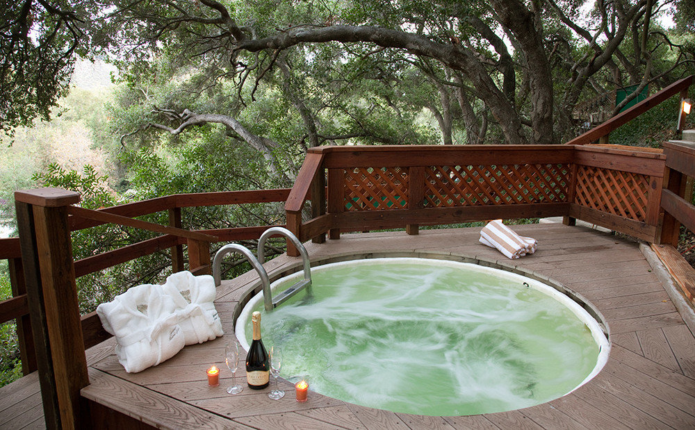 Health + Wellness Hotels Spa Retreats tree table outdoor swimming pool chair property backyard estate furniture yard home Villa Garden Resort cottage arranged
