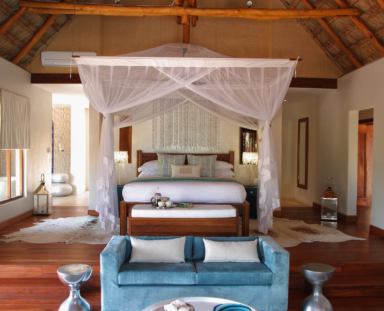bed Bedroom canopy canopy bed charming cozy homey Hotels hut Luxury Rustic indoor floor room ceiling property house estate swimming pool Living home living room interior design cottage Villa mansion Design Resort farmhouse furniture