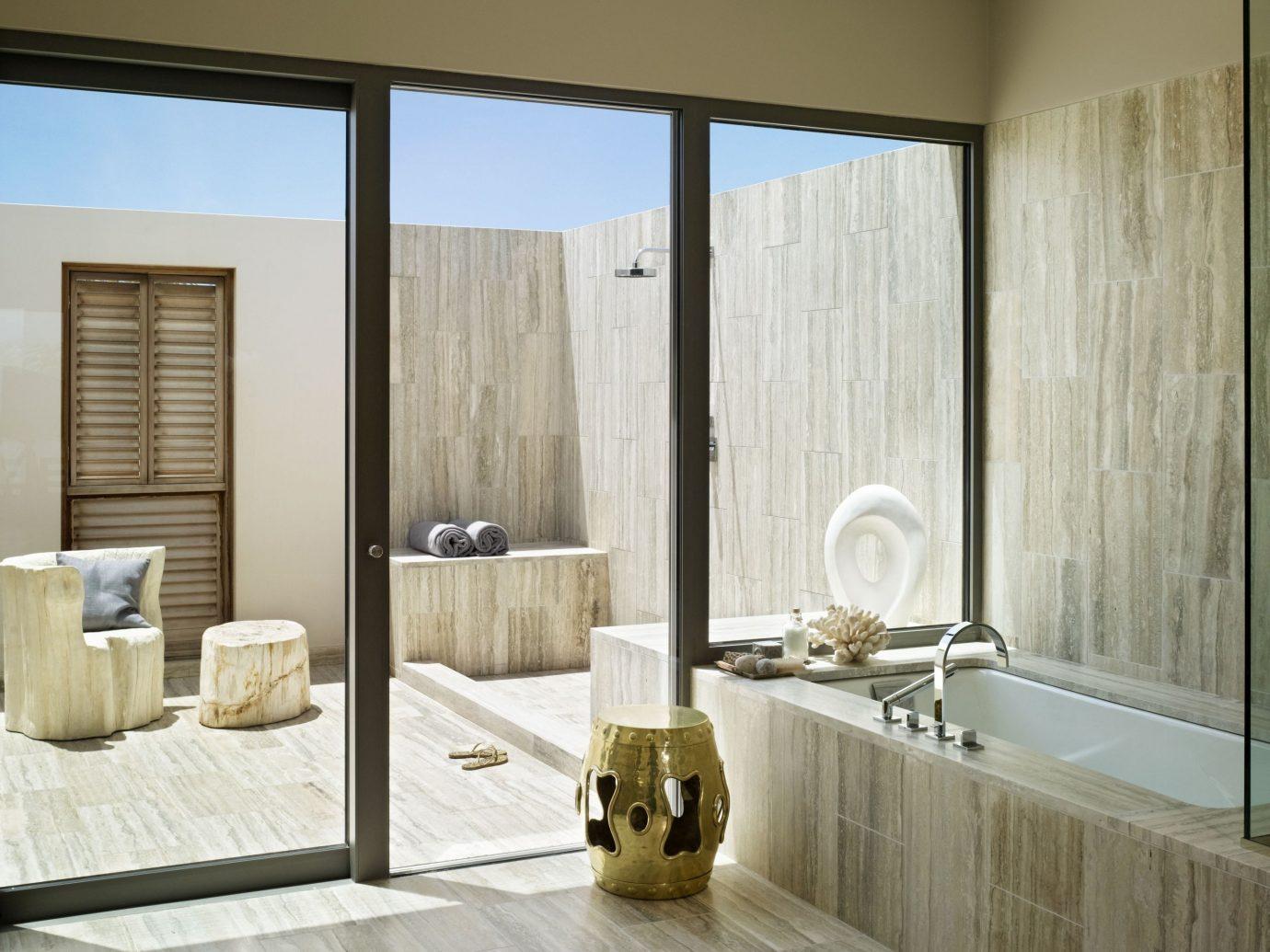 Hotels wall indoor room window property bathroom floor interior design plumbing fixture Design flooring bathtub cabinetry wood Bath