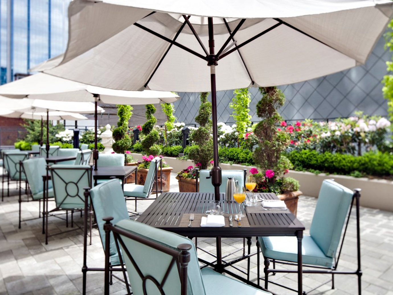 Boutique Classic Dining Drink Eat Hotels Luxury Outdoors Patio table chair backyard outdoor structure umbrella area