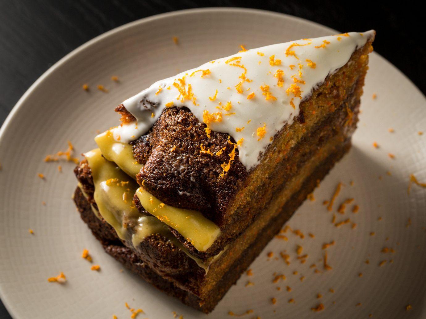 Food + Drink plate cake piece slice dessert food cream chocolate fork frozen dessert ice carrot cake