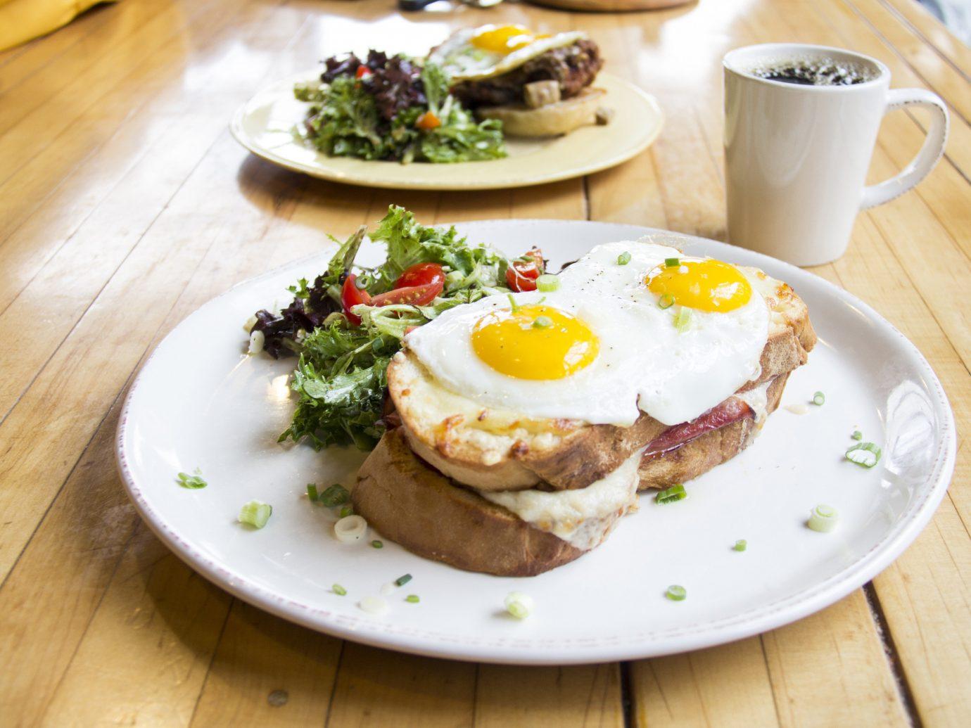 Secret Getaways Trip Ideas table plate food floor dish meal breakfast meat wooden restaurant produce lunch brunch steak cuisine wood