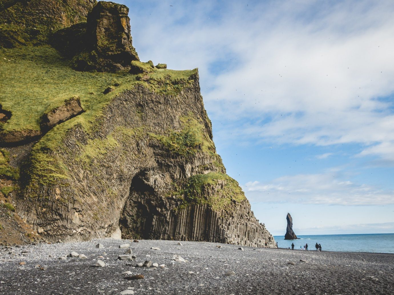 Adventure Beach black sand calm cave Greenery Hotels Iceland isolation Luxury Travel Nature Ocean Outdoor Activities people remote rock Rocks sand serene Travel Tips Trip Ideas outdoor Sea Coast cliff body of water shore vacation terrain cape tower bay material Ruins
