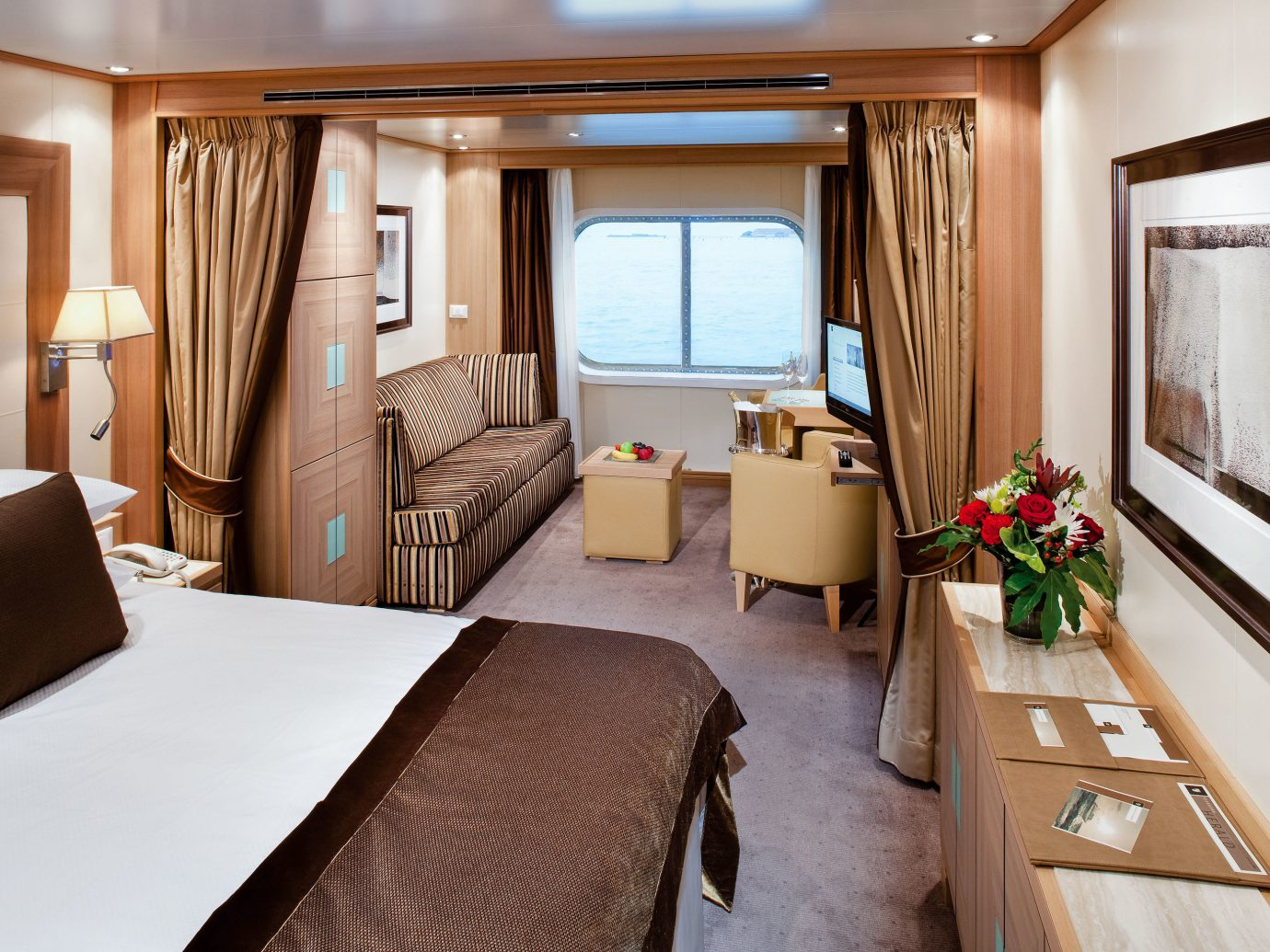 Cruise Travel Luxury Travel Trip Ideas indoor wall room floor window bed ceiling hotel Suite interior design Cabin furniture Bedroom decorated
