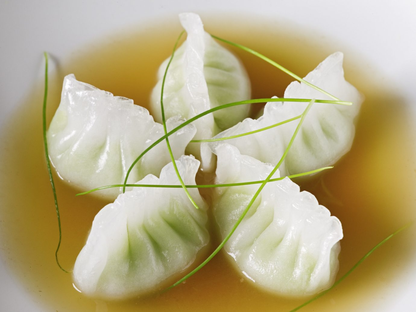 Food + Drink plate food dish cream plant cuisine produce cheese land plant chinese food asian food petal flower vegetable flowering plant sauce dumpling sliced butter arranged
