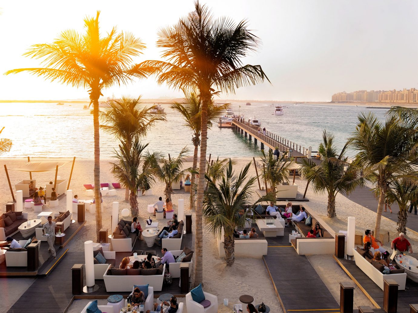 Beach Beachfront Drink Dubai Eat Elegant Hotels Lounge Luxury Luxury Travel Middle East Modern Resort Waterfront sky tree outdoor leisure vacation estate arecales palm plaza plant furniture