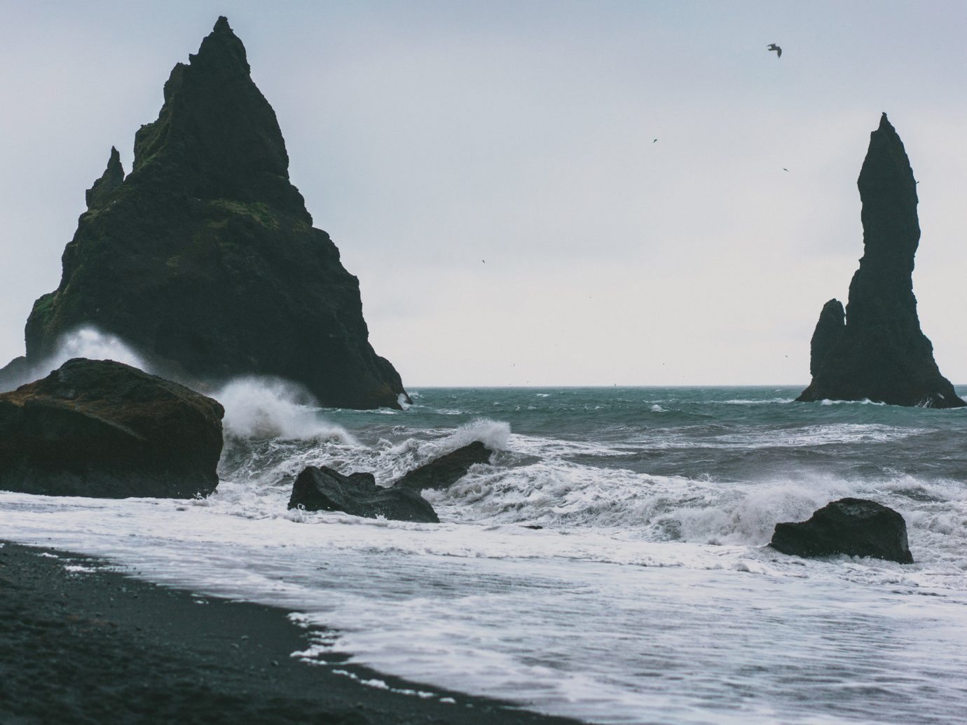 Iceland Outdoors + Adventure outdoor water sky Sea Coast coastal and oceanic landforms Ocean Nature wave headland shore promontory rock mountain wind wave stack rocky cape terrain cliff islet klippe tide formation