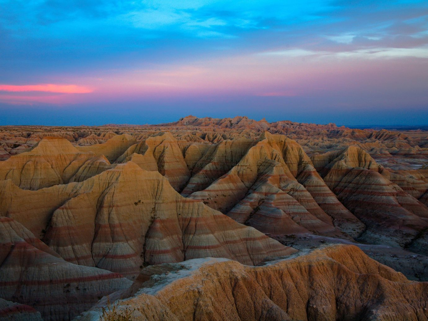 National Parks Outdoors + Adventure Trip Ideas sky Nature valley outdoor geographical feature canyon landform natural environment wilderness badlands horizon rock sunrise Sunset mountain landscape butte plateau wadi cliff geology terrain Sea Coast formation dawn overlooking