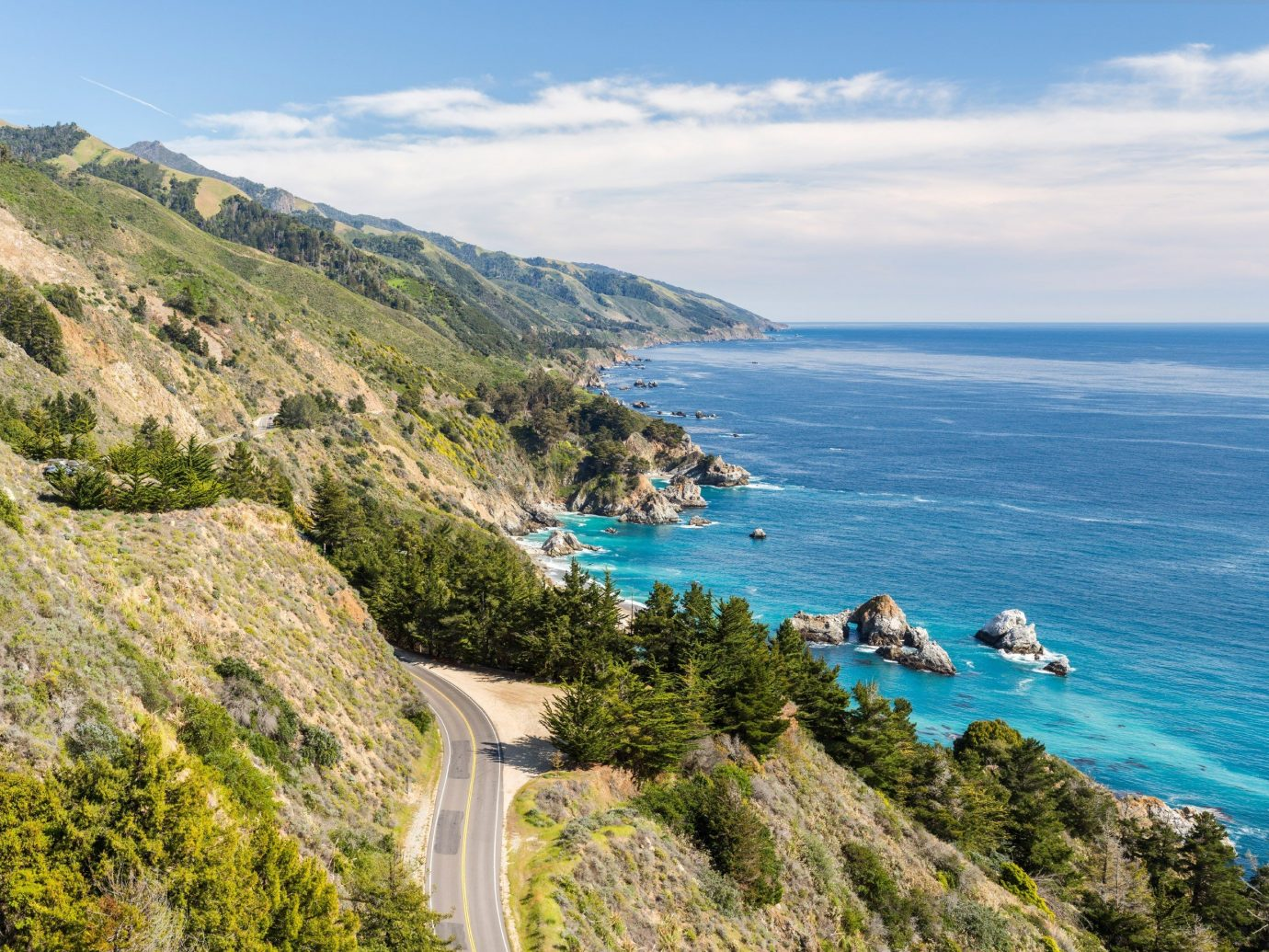 Road Trips Trip Ideas sky outdoor mountain Nature water Coast landform body of water Sea vacation hill cliff Ocean tourism hillside overlooking cape terrain bay rocky cove Adventure fjord