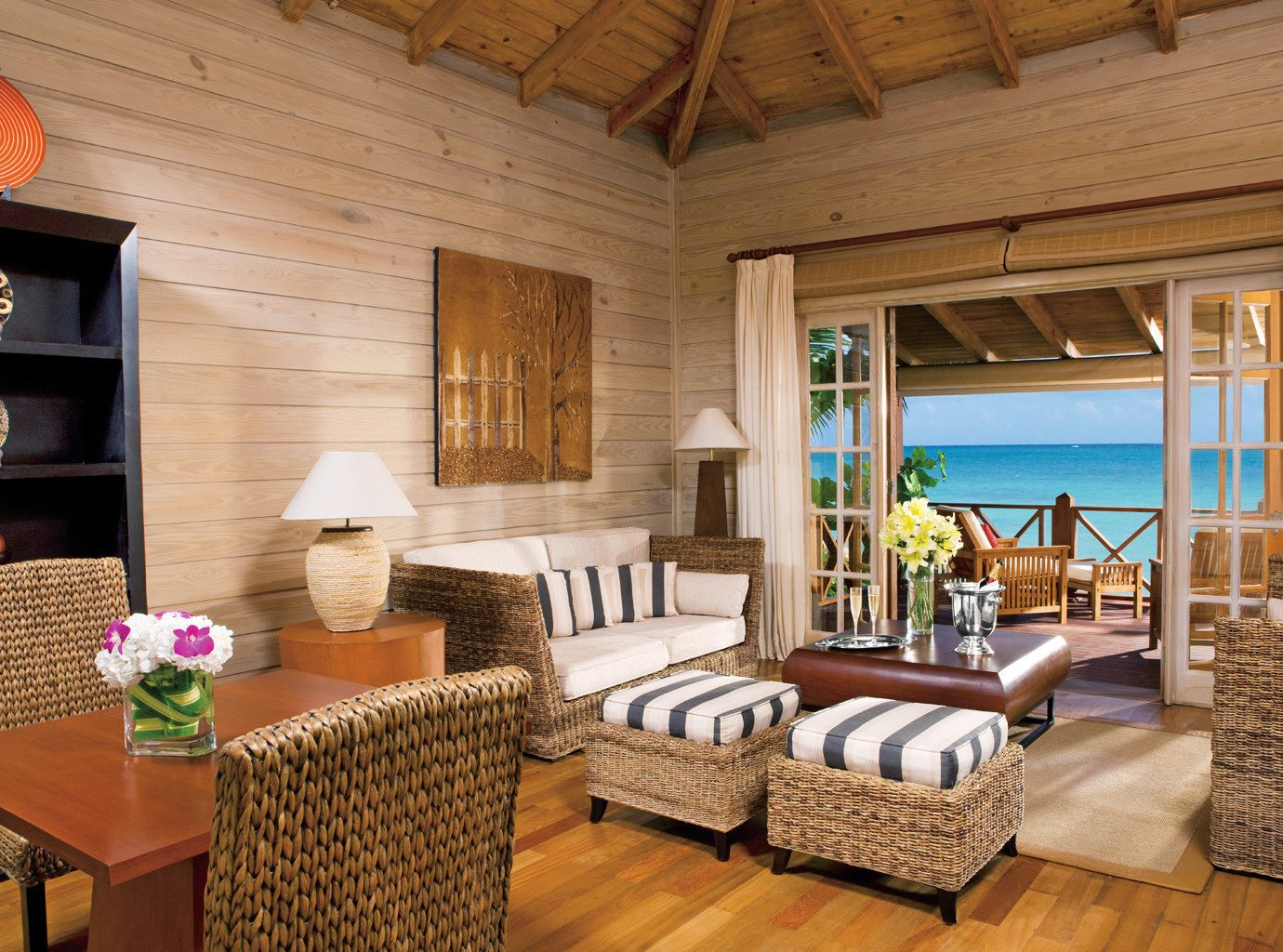 All-Inclusive Resorts Beachfront caribbean Hotels Living Lounge Luxury Modern Romance Scenic views Suite floor indoor room property ceiling chair estate living room cottage home Villa farmhouse hardwood real estate interior design log cabin furniture area wood