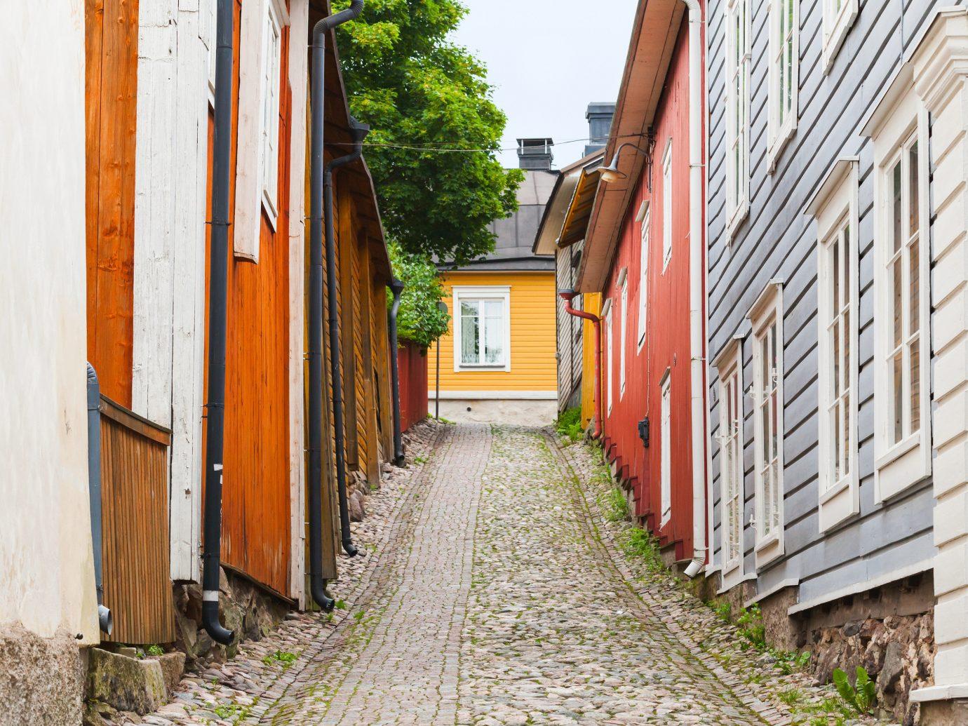 Finland Trip Ideas outdoor Town alley neighbourhood road street house wood facade window tree cobblestone lane way sidewalk