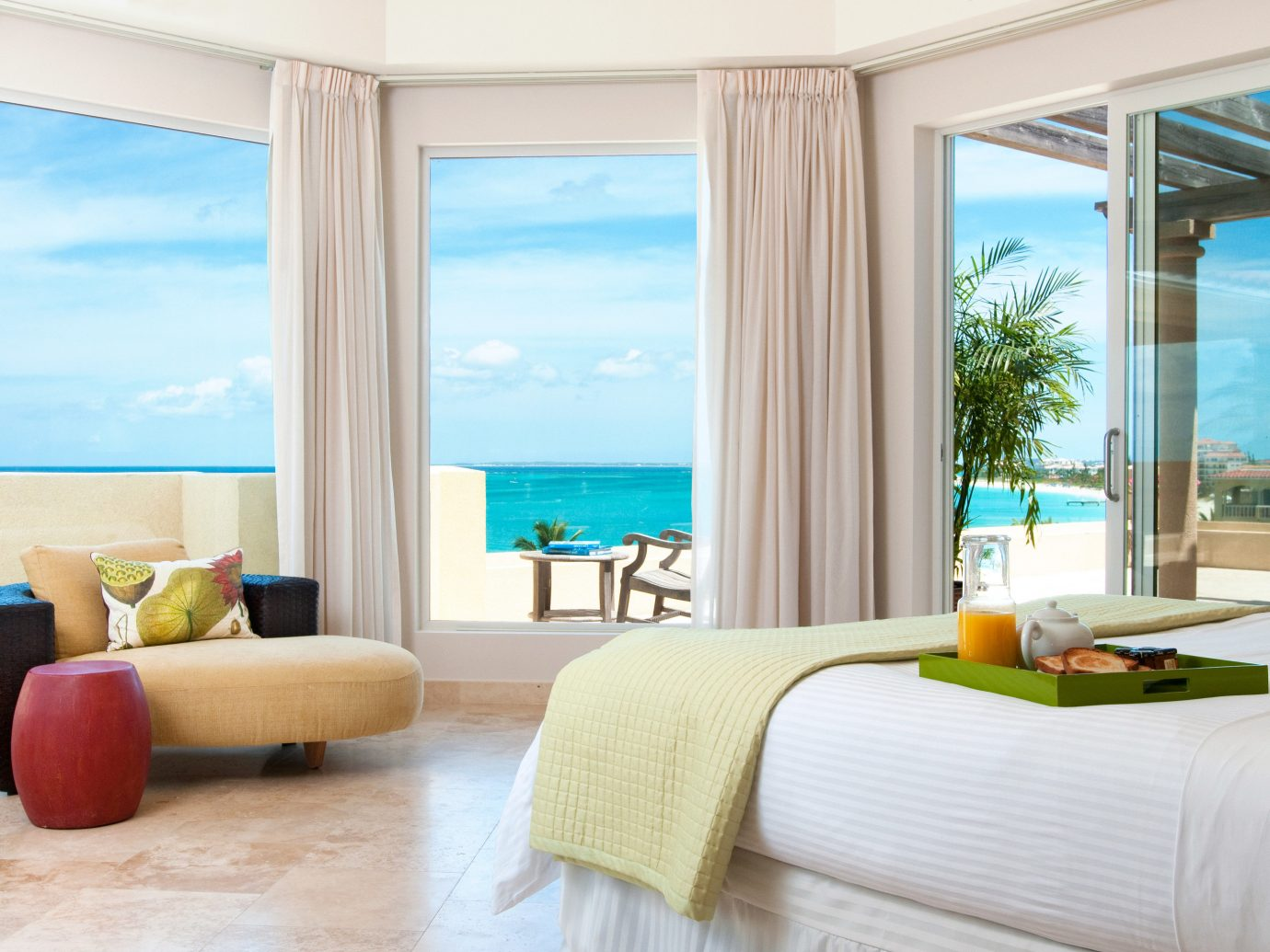 Beachfront Hotels Living Luxury Romance Scenic views window indoor floor sofa room property ceiling hotel living room bed nice interior design condominium home real estate Suite furniture window covering overlooking estate Design apartment flat decorated