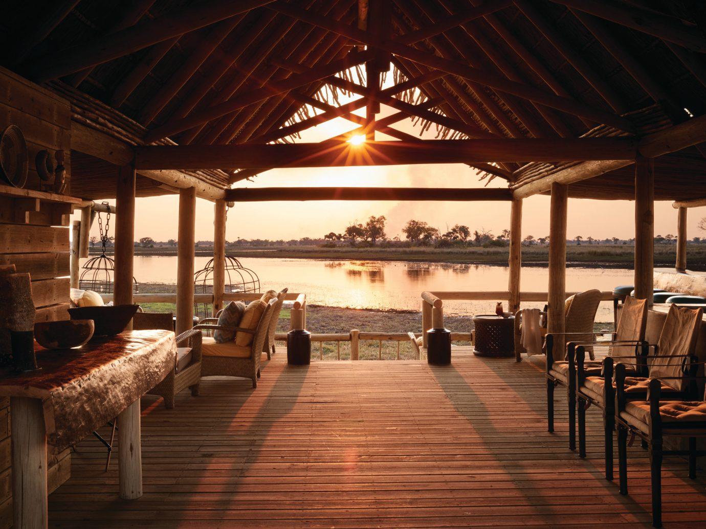 Trip Ideas table floor indoor restaurant evening wood Resort interior design furniture several