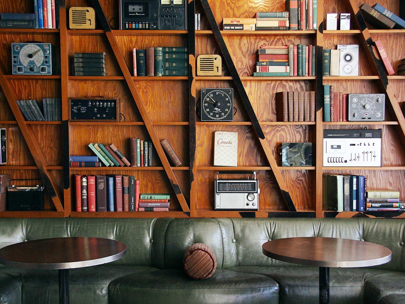 Girls Getaways Trip Ideas Weekend Getaways shelf book indoor floor furniture library building interior design home wood shelving living room bookshelf