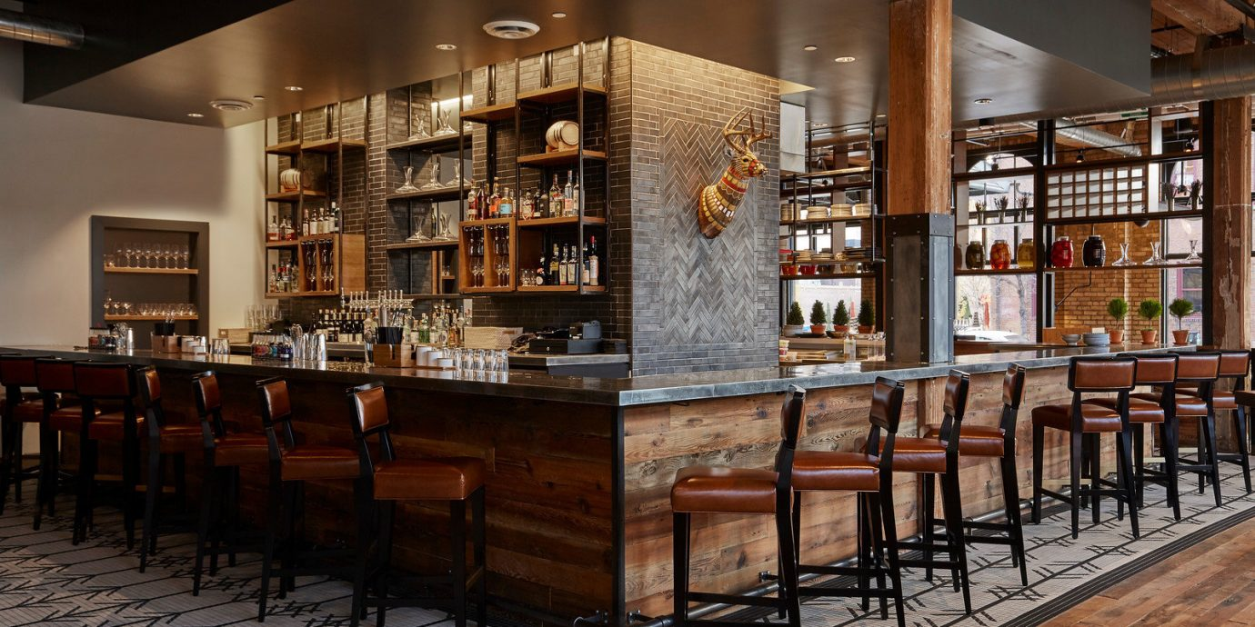Boutique Hotels Fall Travel Hotels Trip Ideas Weekend Getaways indoor ceiling scene wooden Bar interior design bookselling restaurant library liquor store café furniture dining room