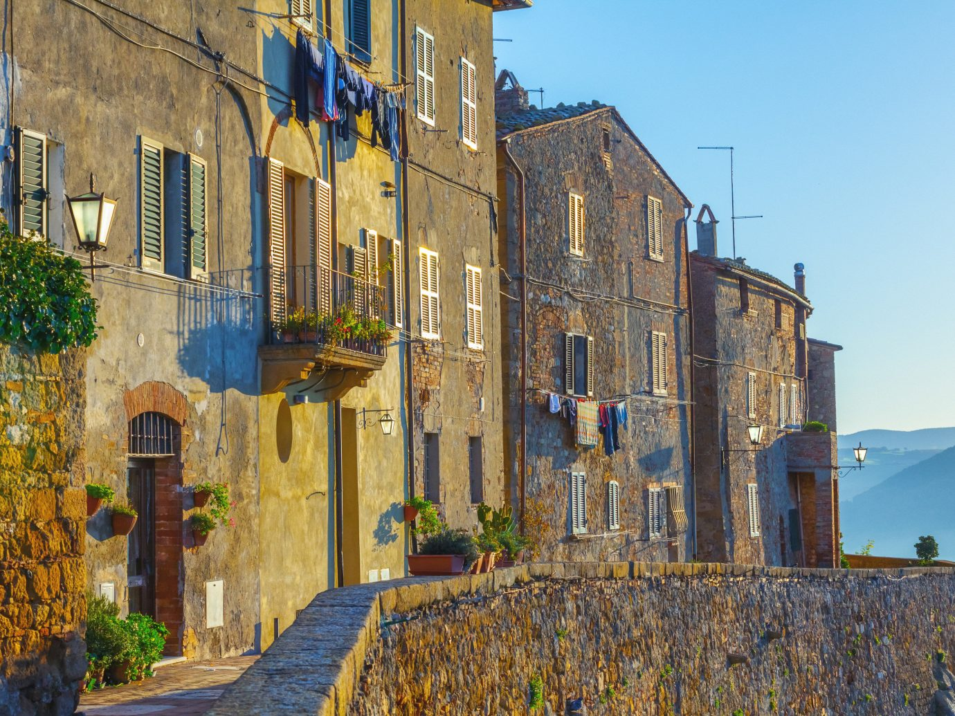 Italy Trip Ideas Town sky property wall neighbourhood City building house facade tree home street window Village history medieval architecture cottage estate plant