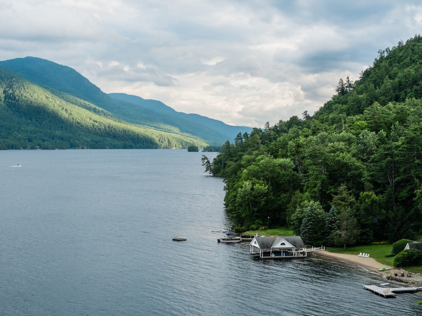Lakes + Rivers Outdoors + Adventure Trip Ideas water outdoor sky mountain Lake Nature Boat mountainous landforms landform geographical feature body of water River loch reservoir fjord floating surrounded vehicle landscape mountain range boating traveling distance Island shore hillside