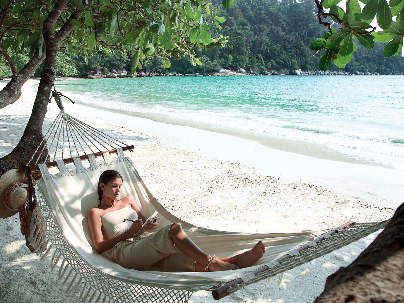 Girl in a hammock at Pangkor Laut Resort, Pangkor, Malaysia