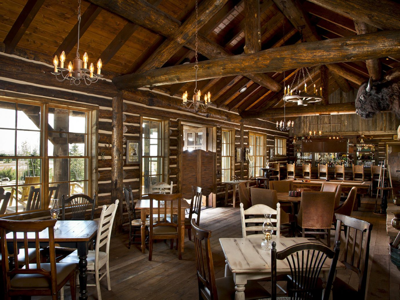 Outdoors + Adventure Trip Ideas indoor table chair ceiling floor room Dining window restaurant estate tavern furniture interior design wood cottage farmhouse area set dining room several dining table